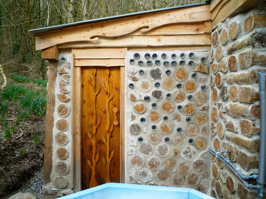 The cordwood sauna: stoke the fire and jump in the plunge pool...