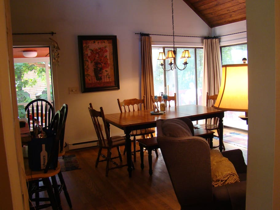 Dining area with sliders to outside deck or screened in porch.