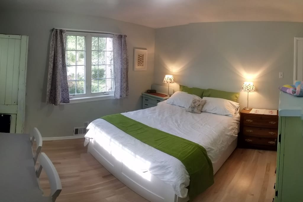 Sunny bedroom with comfortable, new queen bed