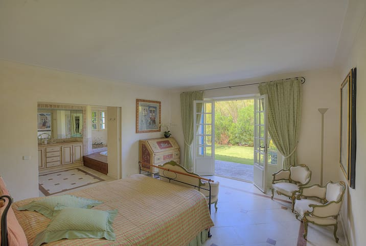 Master bedroom, large bathroom with shower and jacuzzi