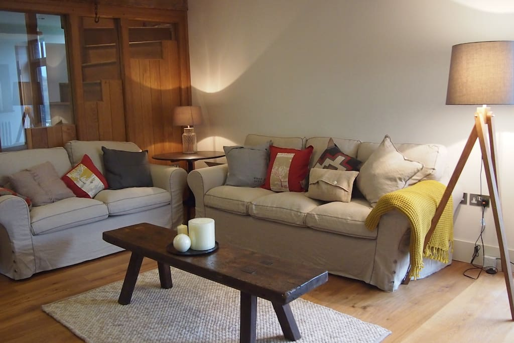 spacious sitting room with wood burning stove