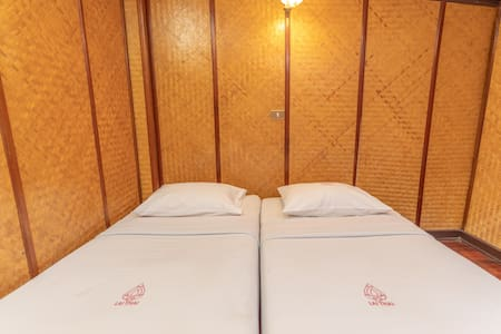 Two (2x) twin bed, Shared Bathroom format.