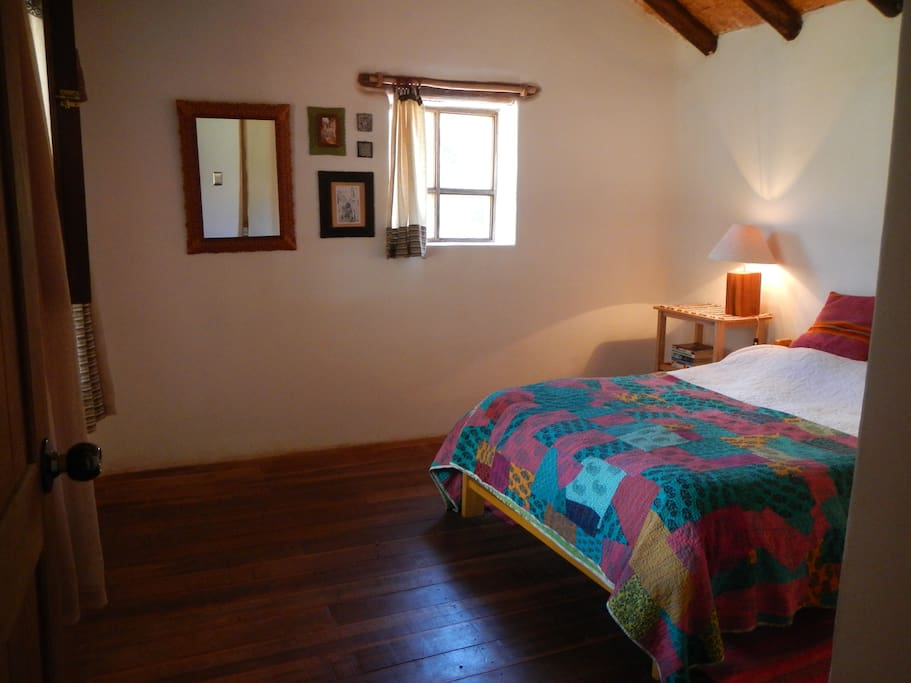 Bedroom with double bed, large closet, and views down the valley onto the mountain