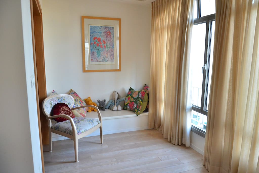 sunny reading corner with additional TV room