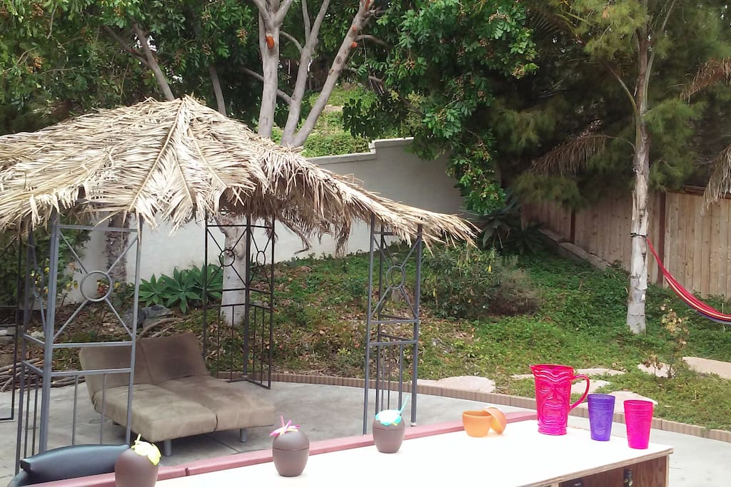 Private outdoor Bar for refreshment, An Organic Palapa Cabana and Hammocks for you.