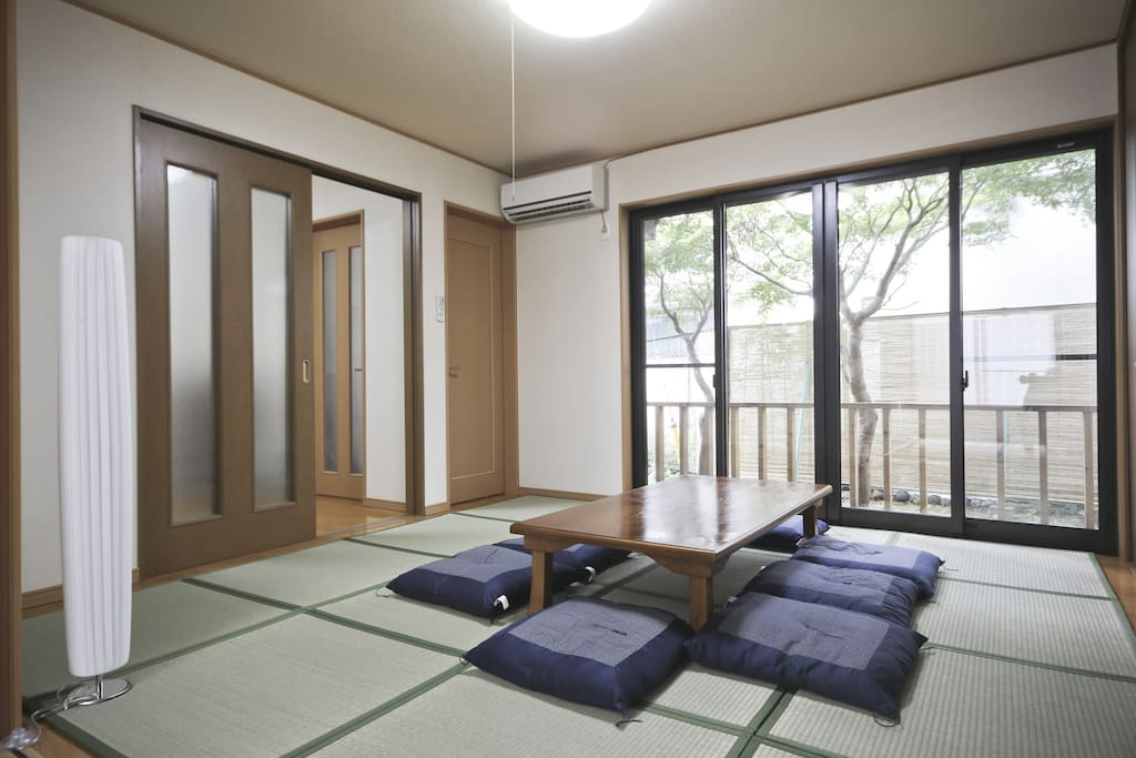 The Tatami mats Living room with a garden view which converts to a sleeping area