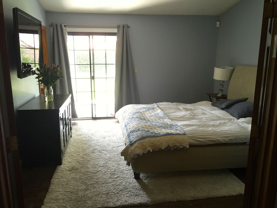 Master bedroom has mounted 60 inch TV with Direct TV. Door goes to back yard.