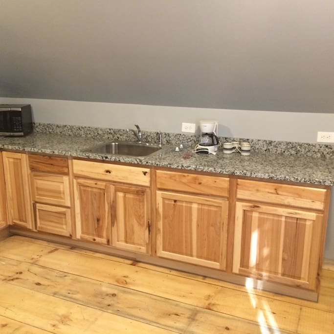 Granite countertops and Hickory cabinets
