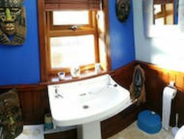 Bathroom for the downstairs triple bedroom. Shower also