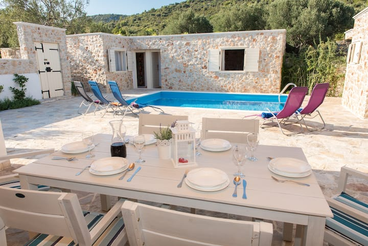 The picturesque stone holiday house with pool