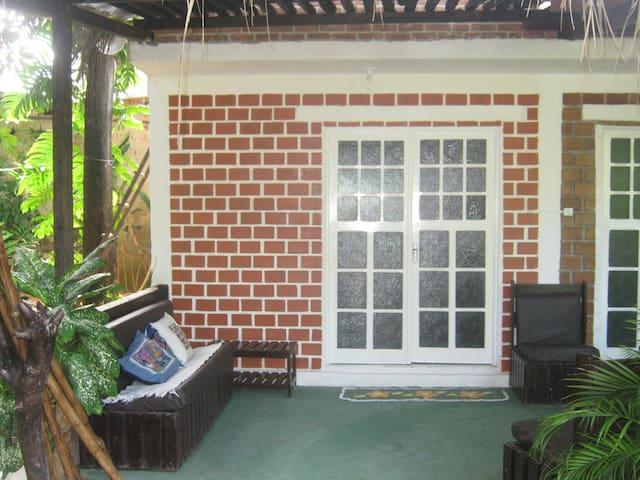 suite casal com varanda no verde