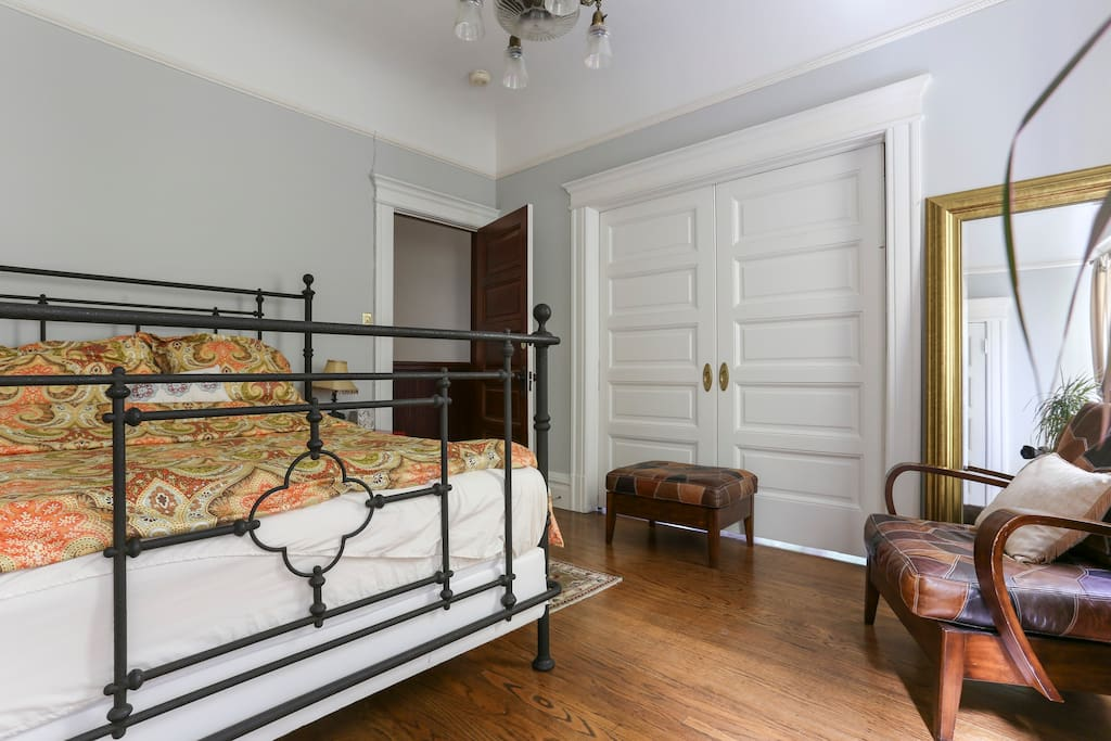 Bedroom with closed parlor doors.