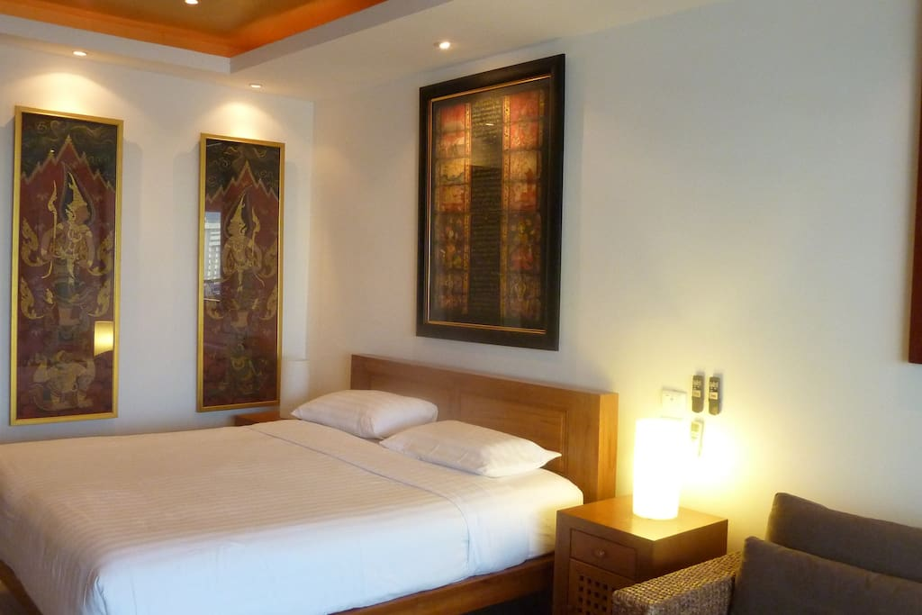 king bed with quality art work and mood lighting
