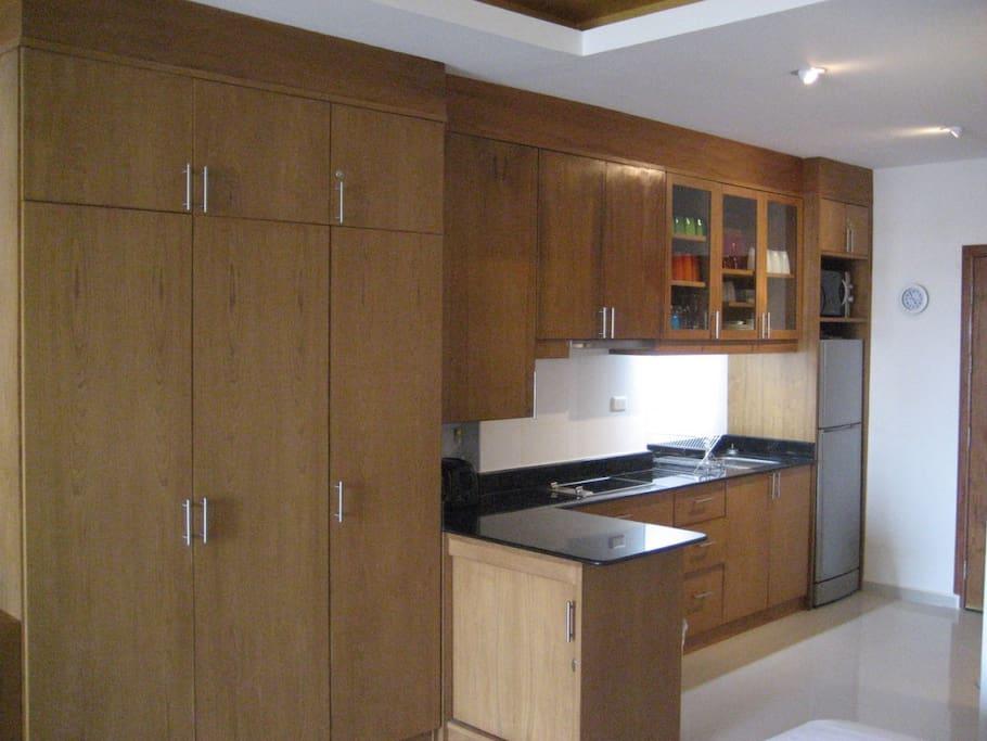 Kitchen with fridge/freezer, dual ceramic hob with crockery to entertain for four