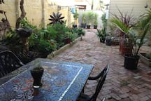 Downstairs courtyard, space to enjoy a beer or wine after a busy day, or breakfast before you head out.