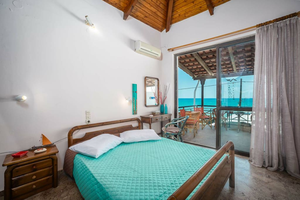 Studio's double bed with view of Laganas bay
