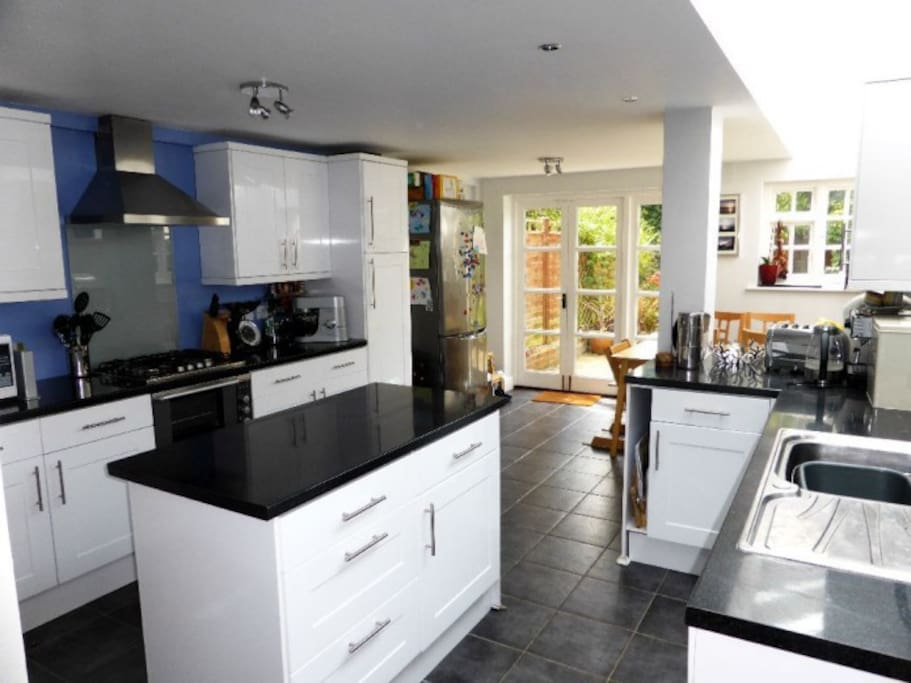 open plan kitchen with American style fridge freezer