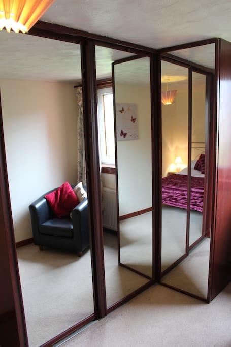Larger double room with ample mirror wardrobe storage