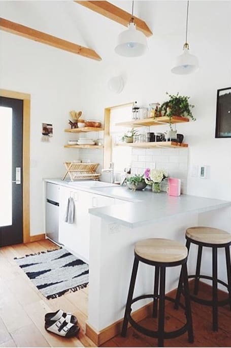 Bright and airy kitchenette with cozy seating for two. Photo by local designer Emily Katz.