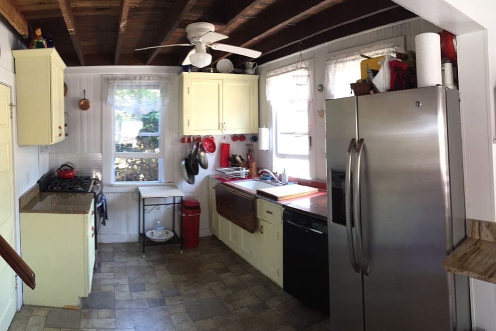 Chef's kitchen with contemporary appliances including  Bosch dishwasher, GE Profile gas range and Refrigerator.