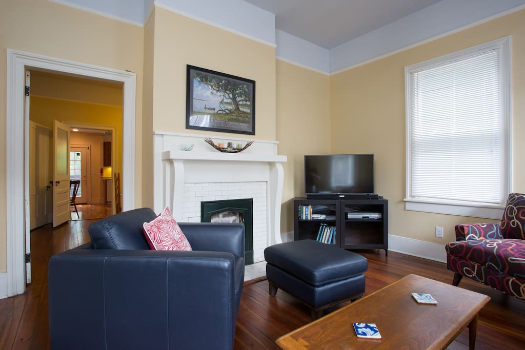 Living Room with entertainment center featuring 42' Smart TV and sound bar.