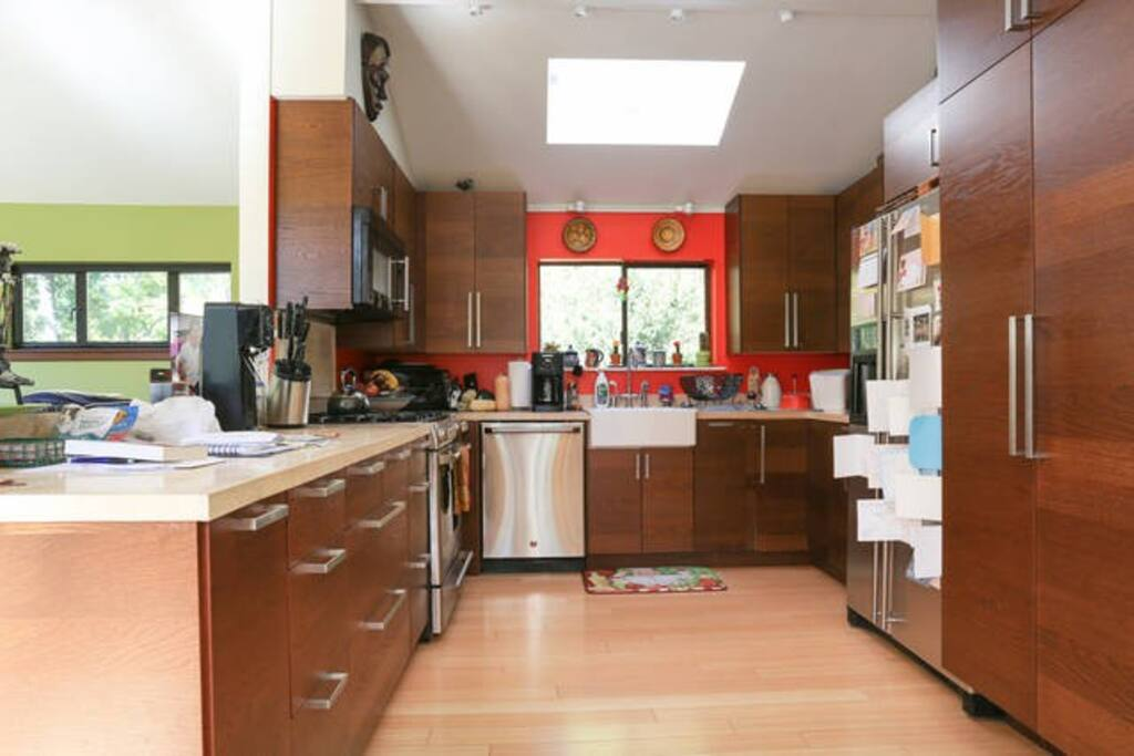 Kitchen with gourmet accessories, spices and pantry items for your use.