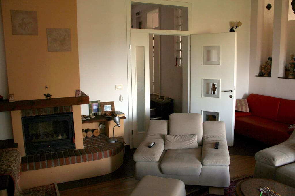 Access to causy living room with a fireplace and cable TV