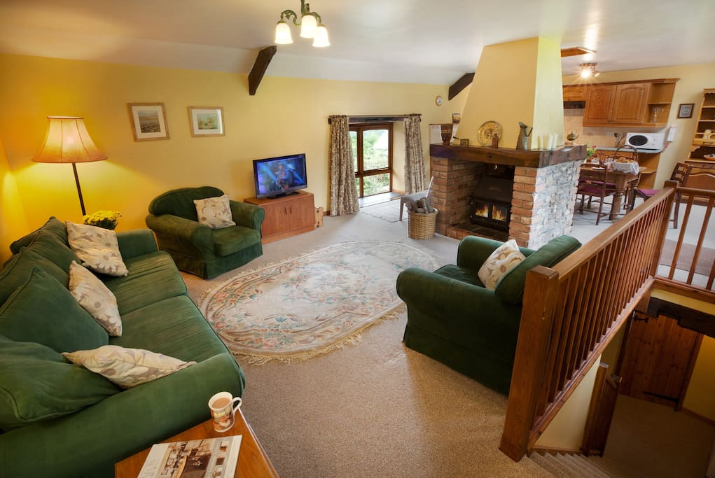 Open plan upstairs with cosy wood burner