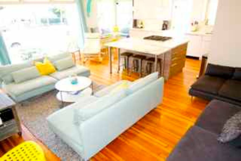 Entertain in our Beachy open concept living room, super large marble bar/ kitchen island with plenty of seating to view huge flat screen tv mounted now on the wall.