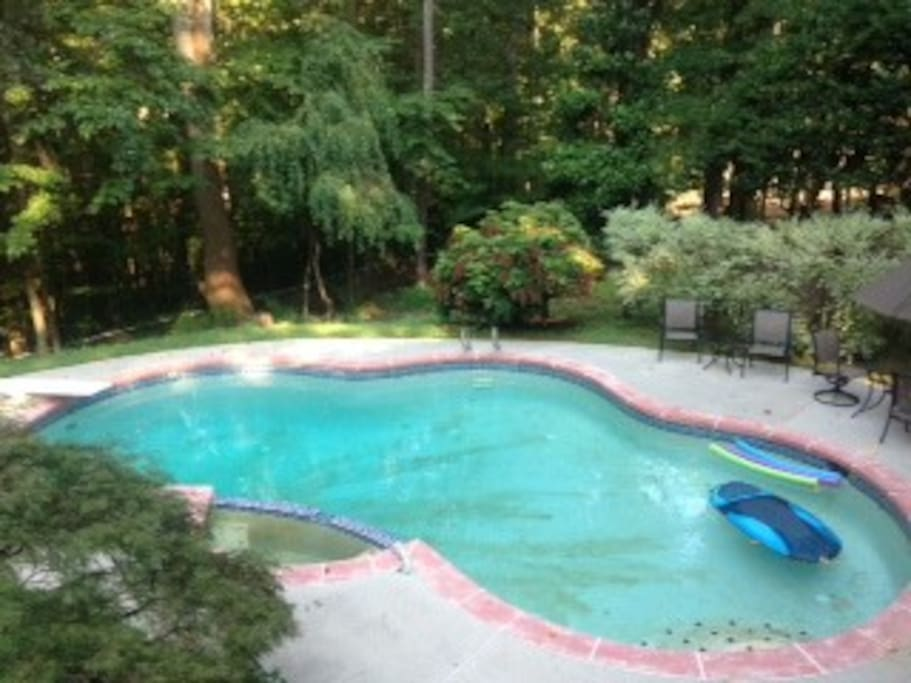Right outside your door surrounded by Stone Mountain's forest is a 37,000 gallon  in-ground pool with outdoor lounge furniture to relax, sun, or work w/ WiFi.