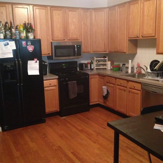 Kitchen attached to the living room with all essentials. Dishwasher, Fridge w/ ice machine, garbage disposal