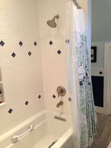 2nd floor bathroom shower and soaker tub for guest use