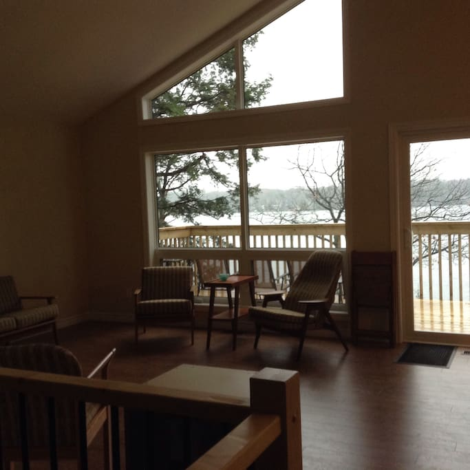 view of lake from The Great Room with balcony outside.