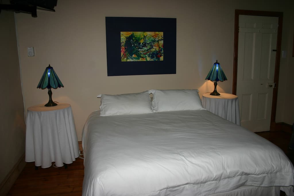 Mont Blois en-suite room with twin beds, TV and comfortable chairs. Access inside house.