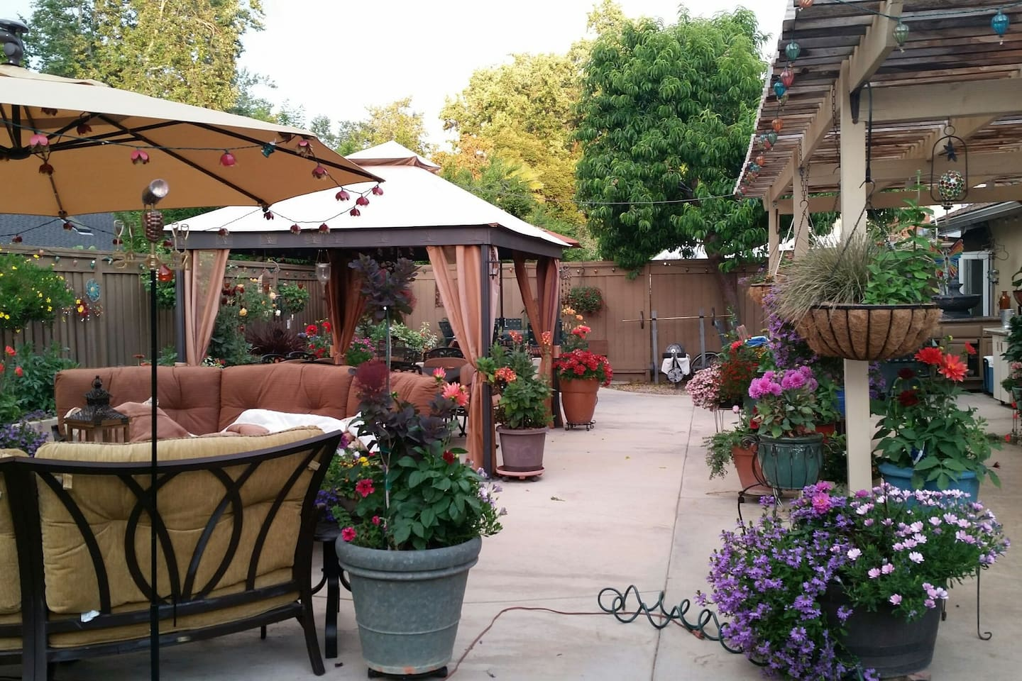 Outdoor patio with dining table and conversation seating area