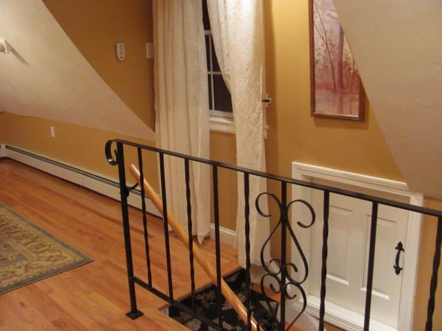 Wrought iron rail & hardwood flooring