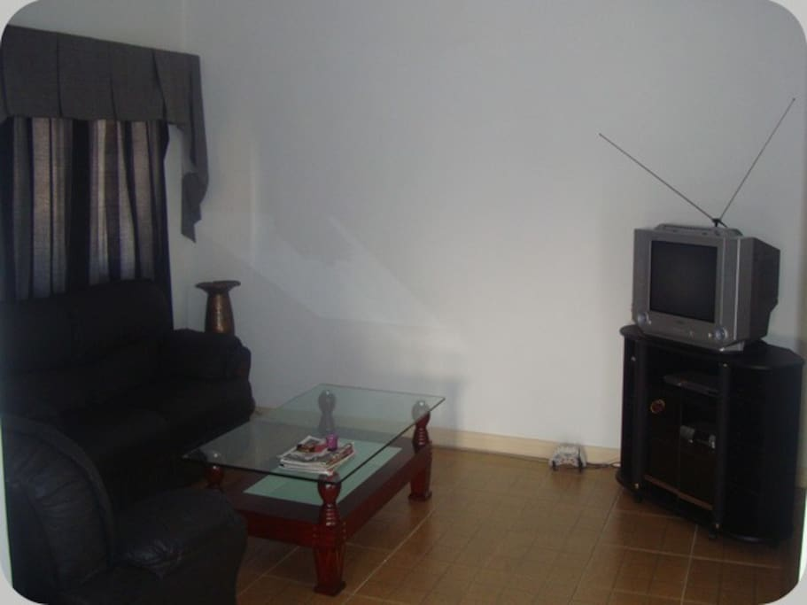 The One Bedroom Self Service Sitting Area with the TV.