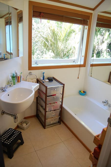 Shared bathroom with leafy views