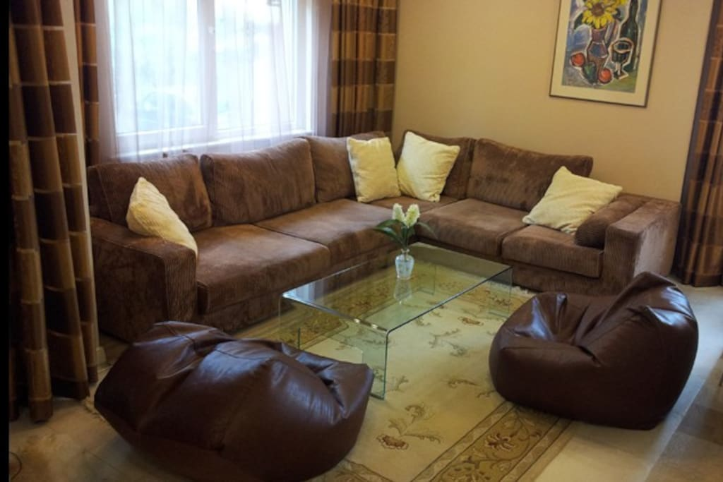 Living room - a very very comfortable couch with a coffee table