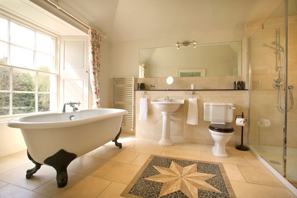 The Rose Garden Room's en suite bathroom, with roll top bath and shower.