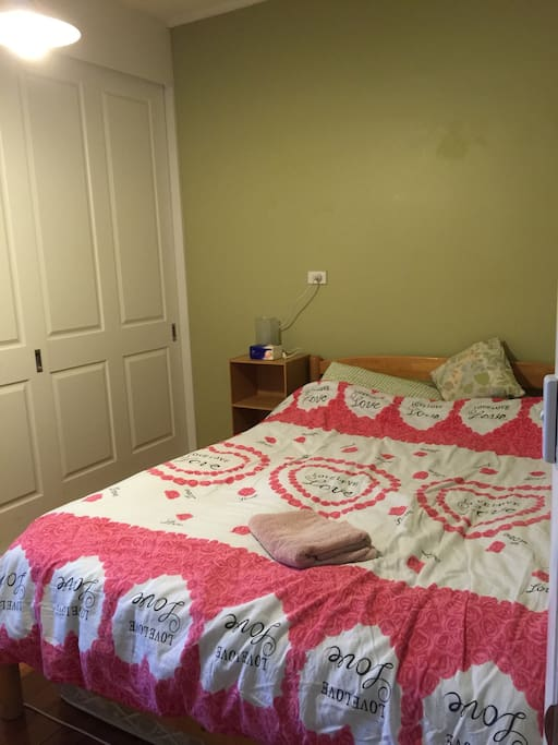 nice queen bed with a desk and chair