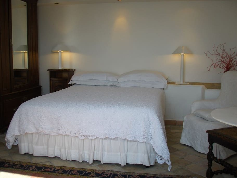 ... bedroom area with white linen...