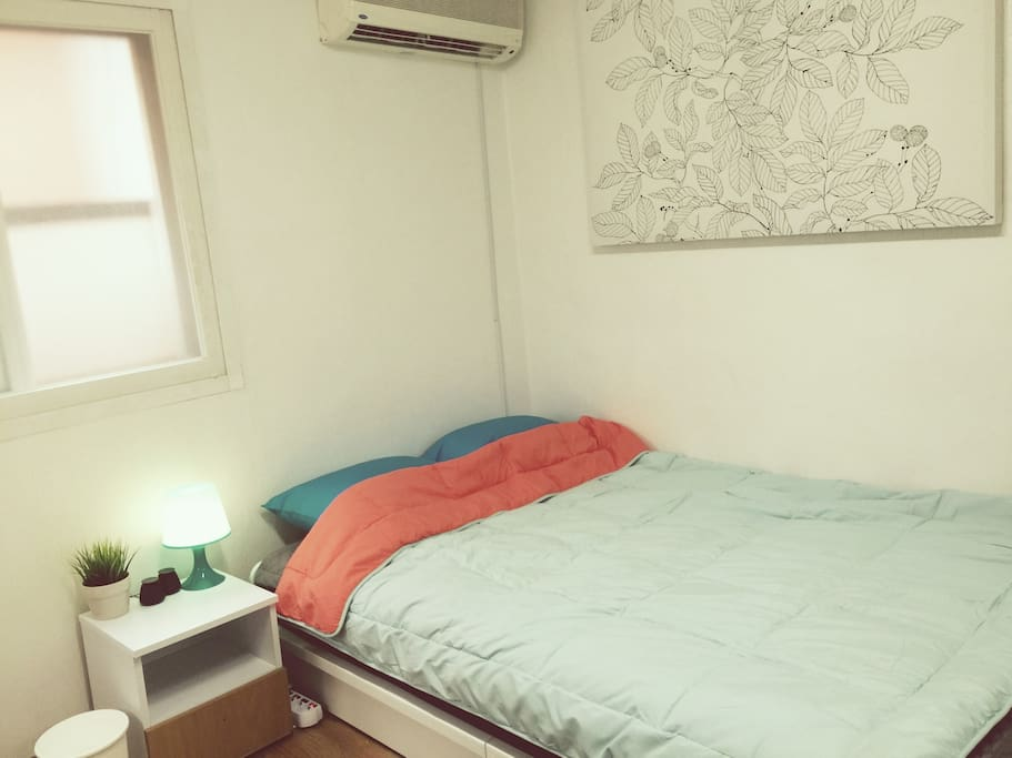 Comfortable double bed (expensive individual spring), a bedroom with a large canvas.
