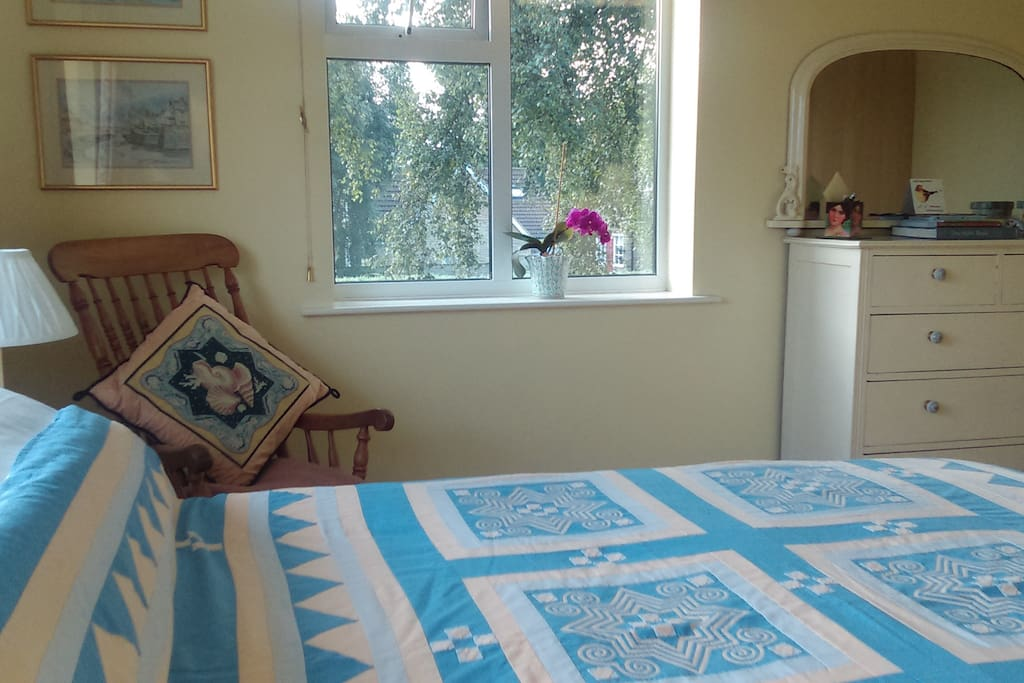New King size bed and hand made quilt in roomy bedroom 2 overlooking the garden