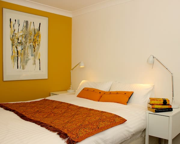 Main bedroom clean and modern with fluffy doona for a comfortable sleep