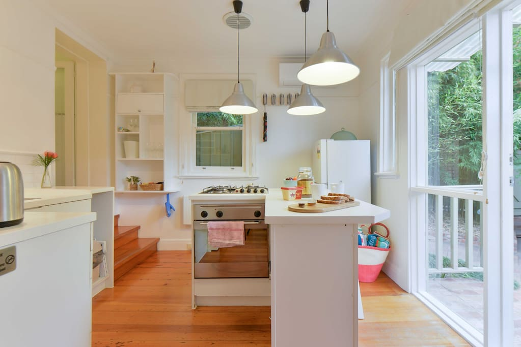 Fully equipped kitchen and breakfast bar with garden views - split system reverse cycle air conditioning