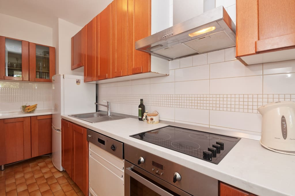 Very well equiped kitchen includes fridge, dishwasher, stove, toster and waterheater
