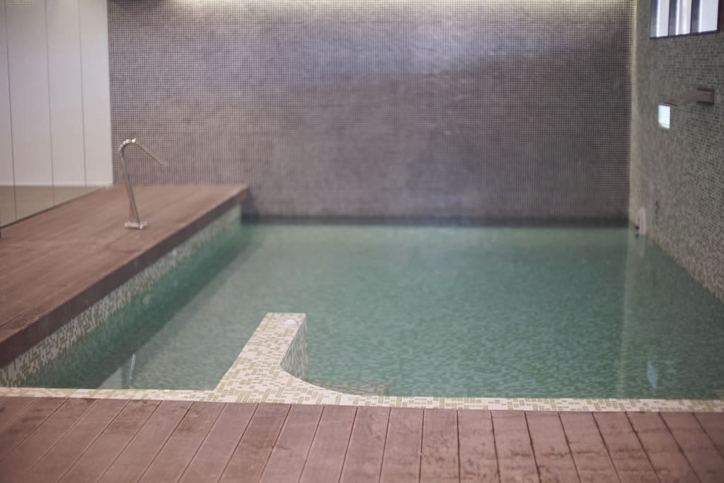 Indoor heated pool with water jets, water blades and resistance swimming pump