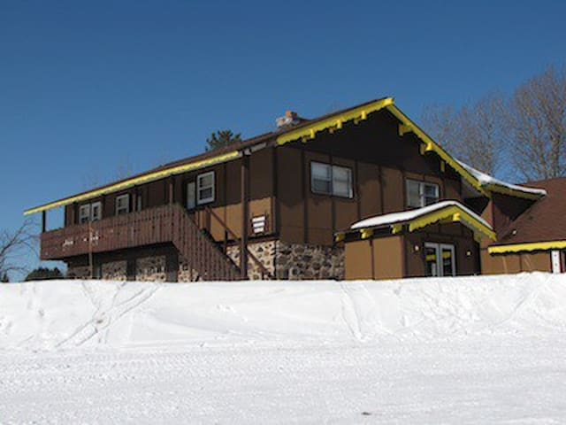 Three upper rooms facing ski hill. Lower room with Mt. View.