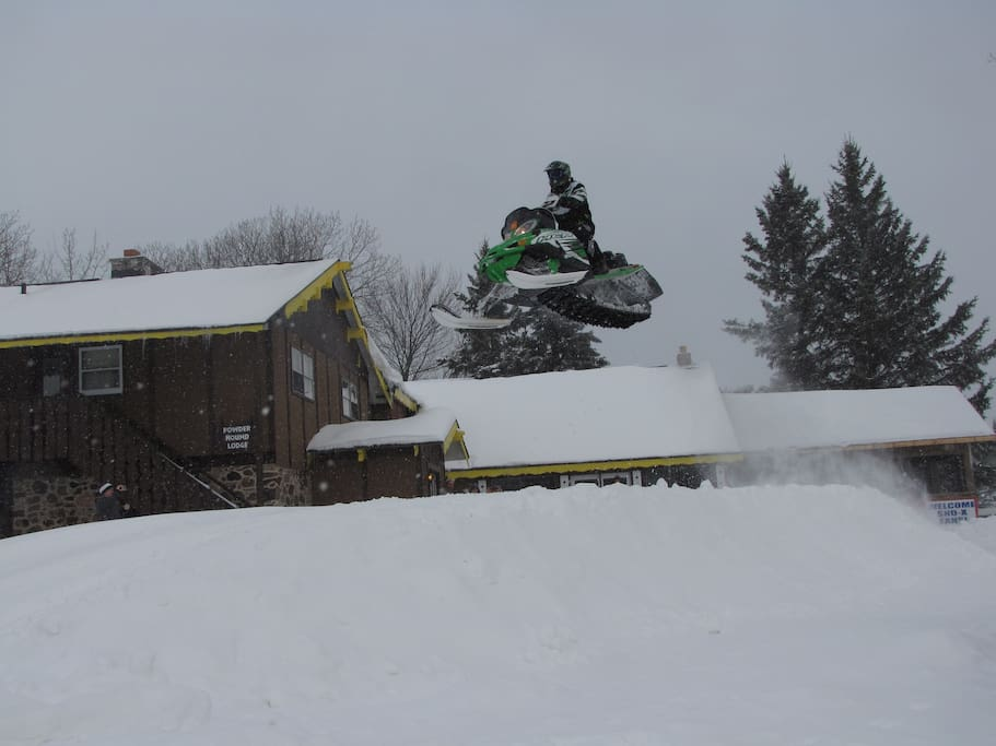 Group of snowcross racers taking off for the day's ride.